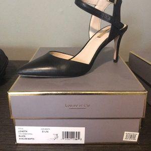 Black sling back heel